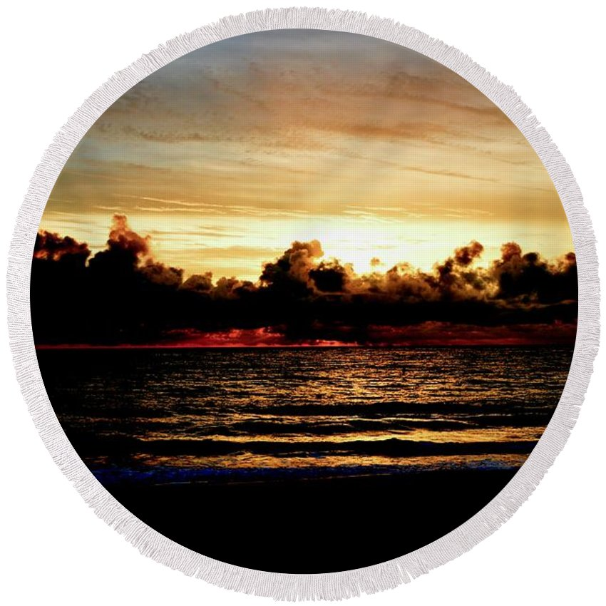 Ocean Round Beach Towel featuring the photograph Stormy Sunrise Over The Ocean by Ernest Litterick