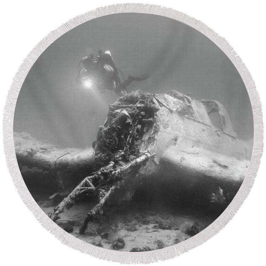 Stuka Bomber Round Beach Towel featuring the photograph stuka bomber wreck II by Claudia Weber-Gebert