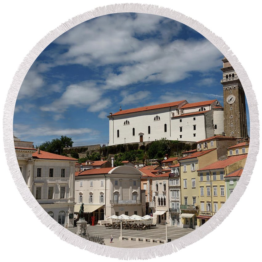 St. George's Round Beach Towel featuring the photograph Sunny Tartini Square In Piran Slovenia With Government Building, by Reimar Gaertner