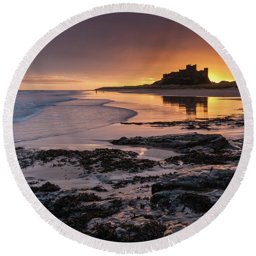 Sunrise Round Beach Towel featuring the photograph Sunrise at Bamburgh Castle #4, Northumberland, North East England by Anthony Lawlor