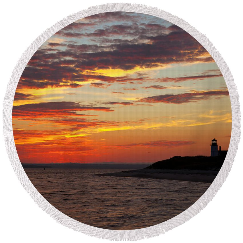 Sunset Round Beach Towel featuring the photograph Sunset Over Sandy Neck Lighthouse by Charles Harden
