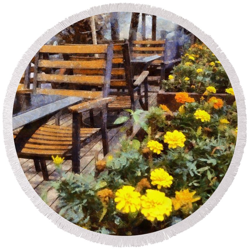 Table And Chairs Round Beach Towel featuring the photograph Tables And Chairs With Flowers by Ashish Agarwal