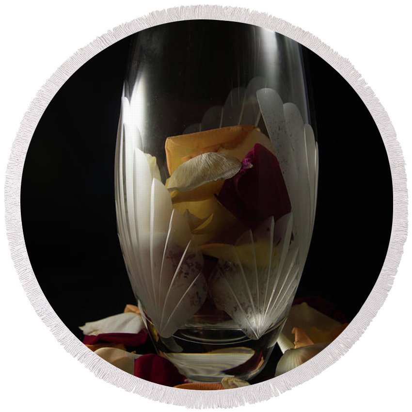 Closeup Round Beach Towel featuring the photograph Tall Crystal Vase With Rose Petals by Jennifer Wick