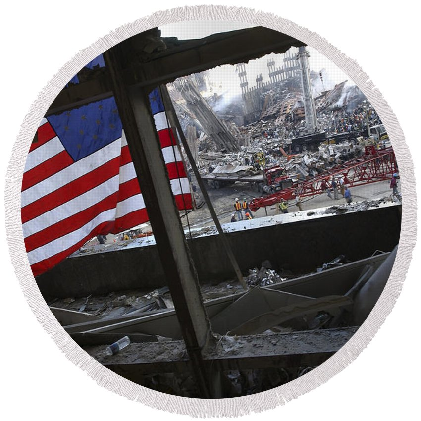 Firefighter Round Beach Towel featuring the photograph The American Flag Is Prominent Amongst by Stocktrek Images