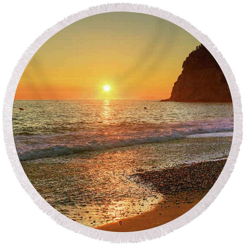 George Westermak Round Beach Towel featuring the photograph the beach and the Mediterranean sea in Montenegro in the summer at sunset by George Westermak