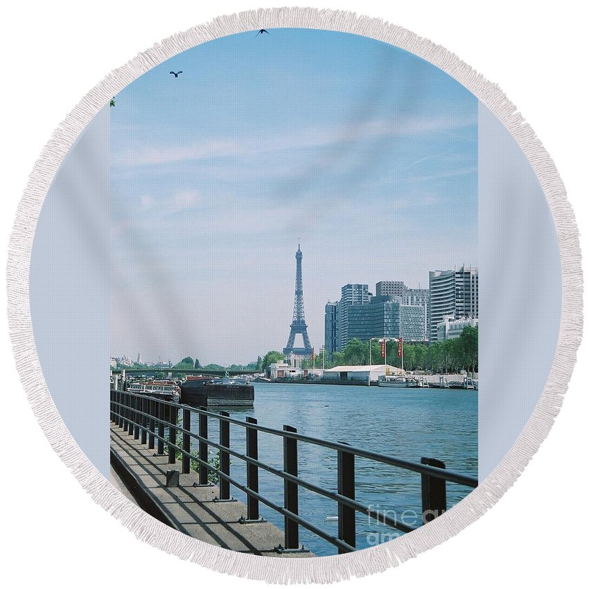 The Eiffel Tower Round Beach Towel featuring the photograph The Eiffel Tower And The Seine River by Nadine Rippelmeyer