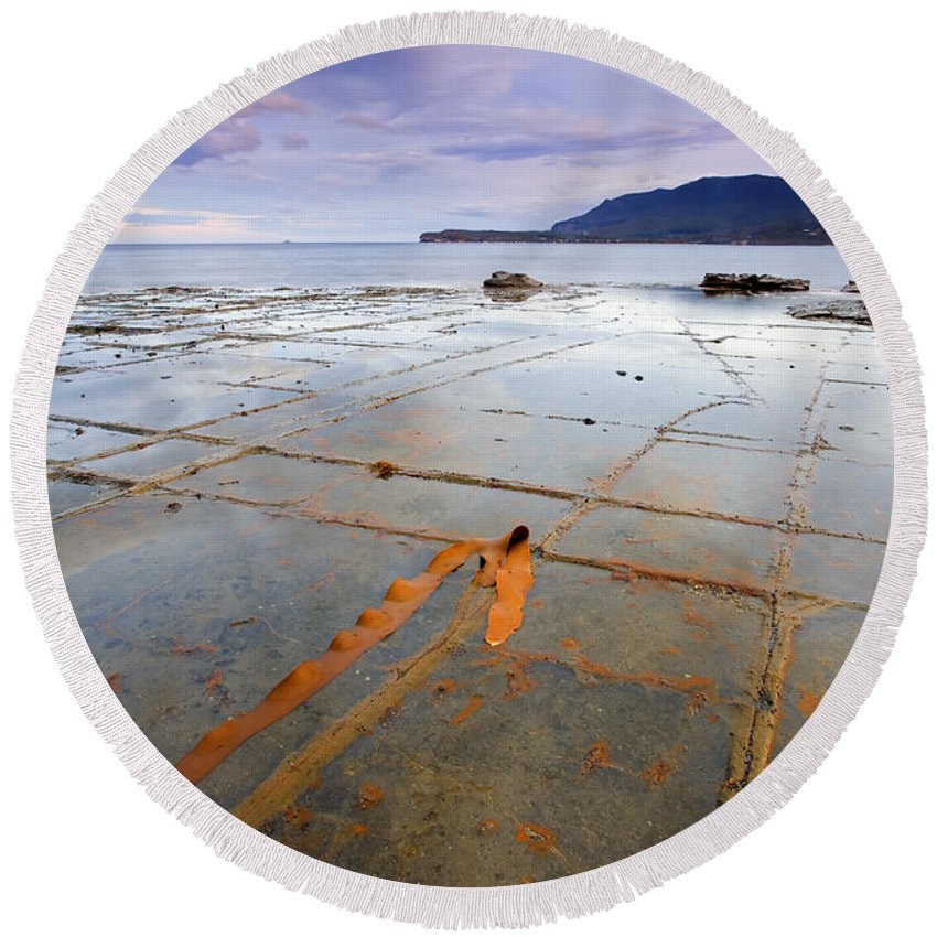 Tesselated Pavement Round Beach Towel featuring the photograph The Grid by Mike Dawson