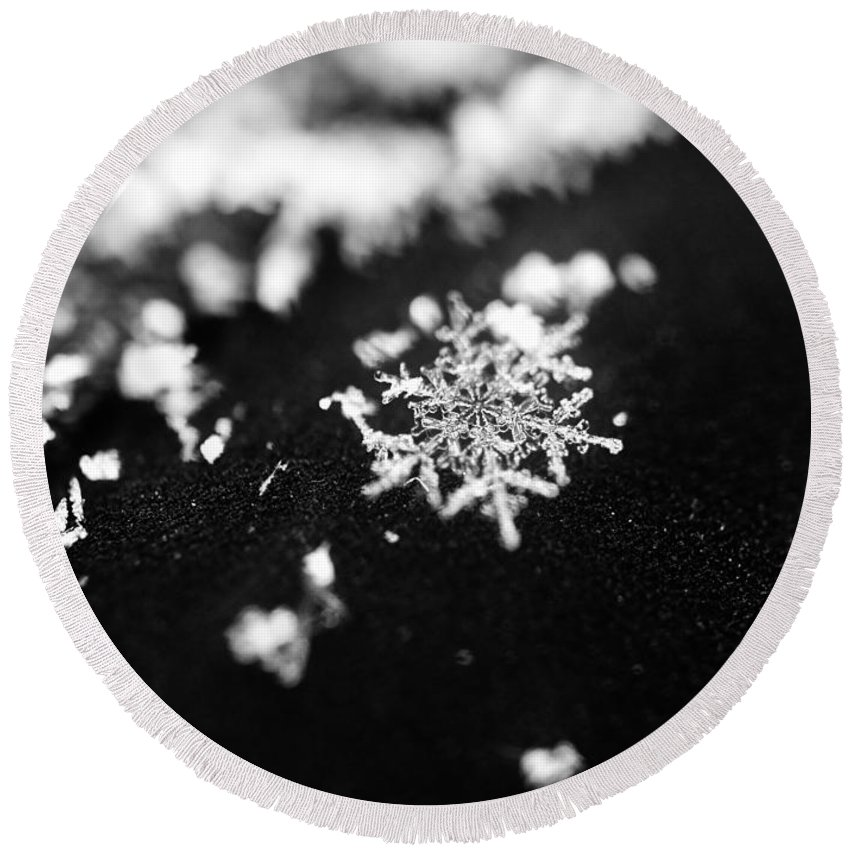 Snowflake Round Beach Towel featuring the photograph The Magic In A Snowflake by Julie Street