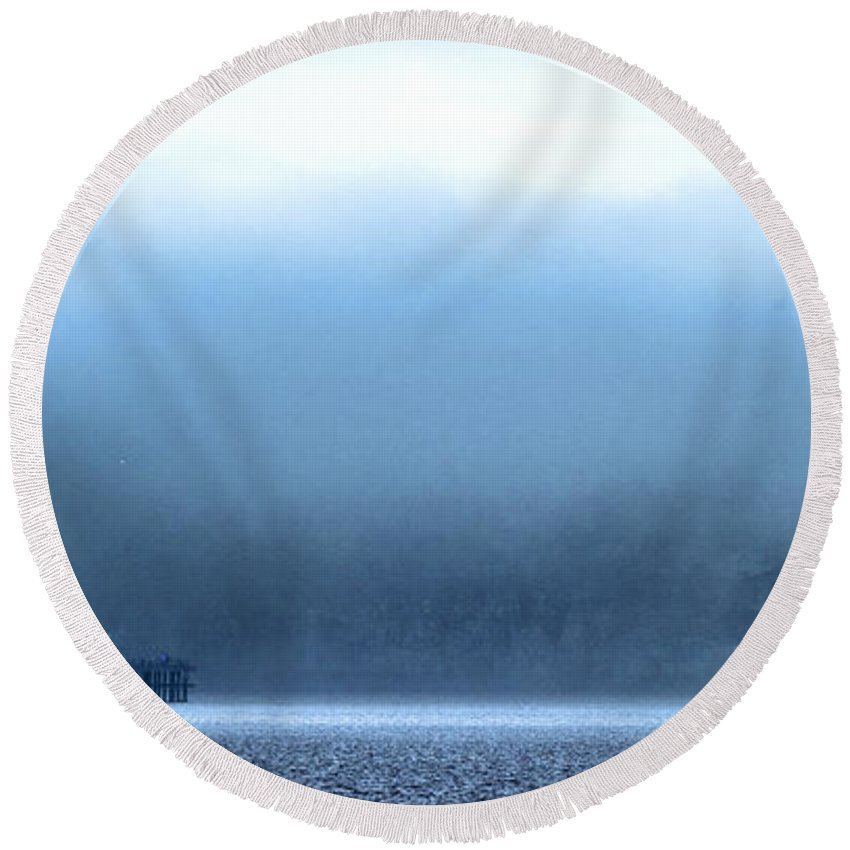 Pier Round Beach Towel featuring the photograph The Sea Mist Lifts To Reveal The Great Orme Behind Llandudno Pier by Mal Bray