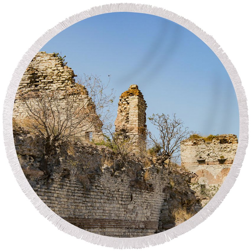 Theodosian Wall Istanbul Turkey Theodosian Walls Stone Stones Brick Grass Grasses Tree Trees Foliage Structure Structures Architecture Ruin Ruins Landscape Landscapes Landmark Landmarks Cityscape Cityscapes Tower Towers Round Beach Towel featuring the photograph Theodosian Walls - View 10 by Bob Phillips