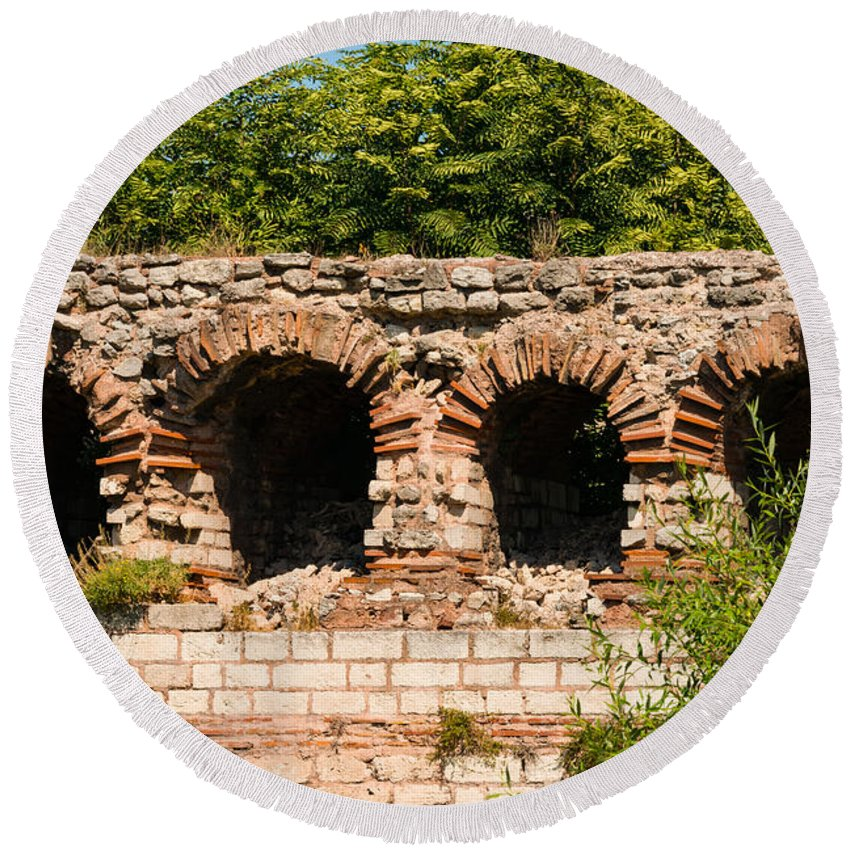 Theodosian Wall Istanbul Turkey Theodosian Walls Stone Stones Brick Tree Trees Foliage Structure Structures Architecture Ruin Ruins Landscape Landscapes Landmark Landmarks Cityscape Cityscapes Arch Arches Round Beach Towel featuring the photograph Theodosian Walls - View 13 by Bob Phillips