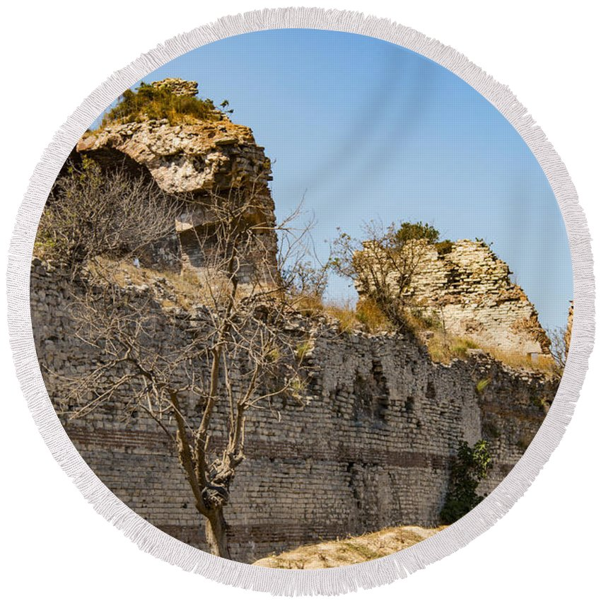 Theodosian Wall Istanbul Turkey Theodosian Walls Stone Stones Brick Grass Grasses Tree Trees Foliage Structure Structures Architecture Ruin Ruins Landscape Landscapes Landmark Landmarks Cityscape Cityscapes Round Beach Towel featuring the photograph Theodosian Walls - View 7 by Bob Phillips