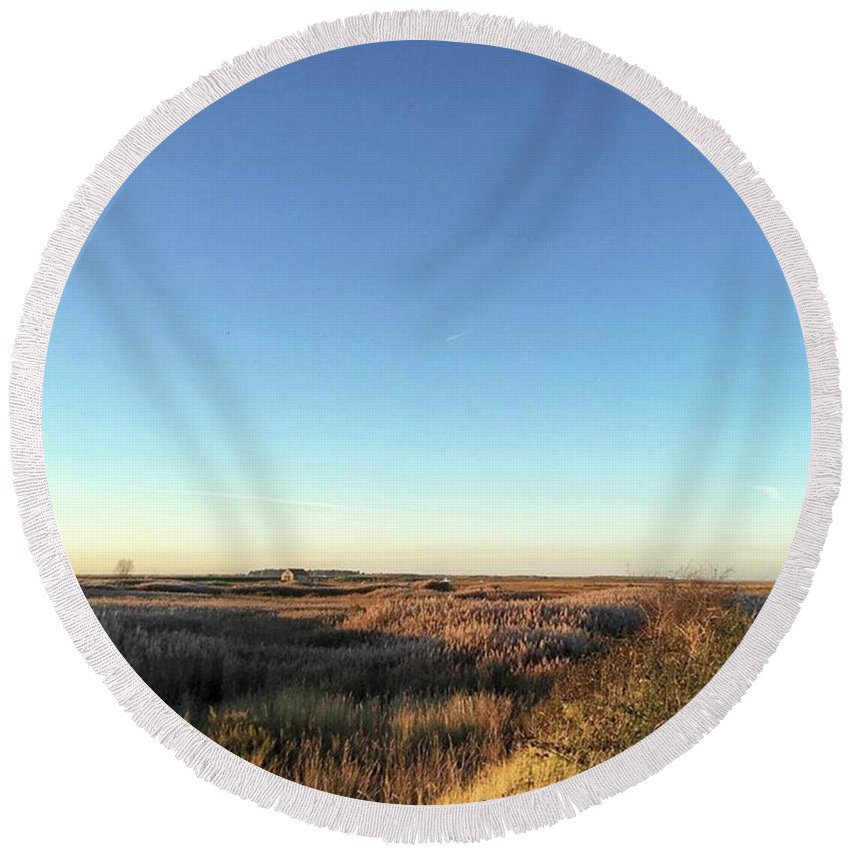 Natureonly Round Beach Towel featuring the photograph Thornham Marsh Lit By The Setting Sun by John Edwards