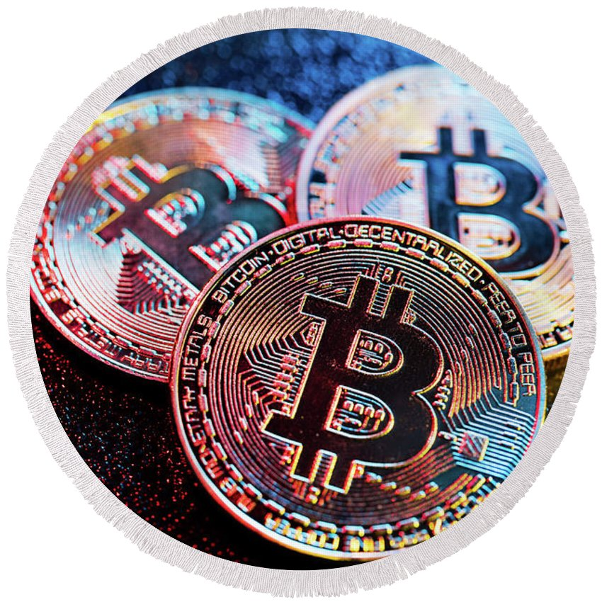 Bitcoin Round Beach Towel featuring the photograph Three Bitcoin Coins In A Colorful Lighting. by Michal Bednarek