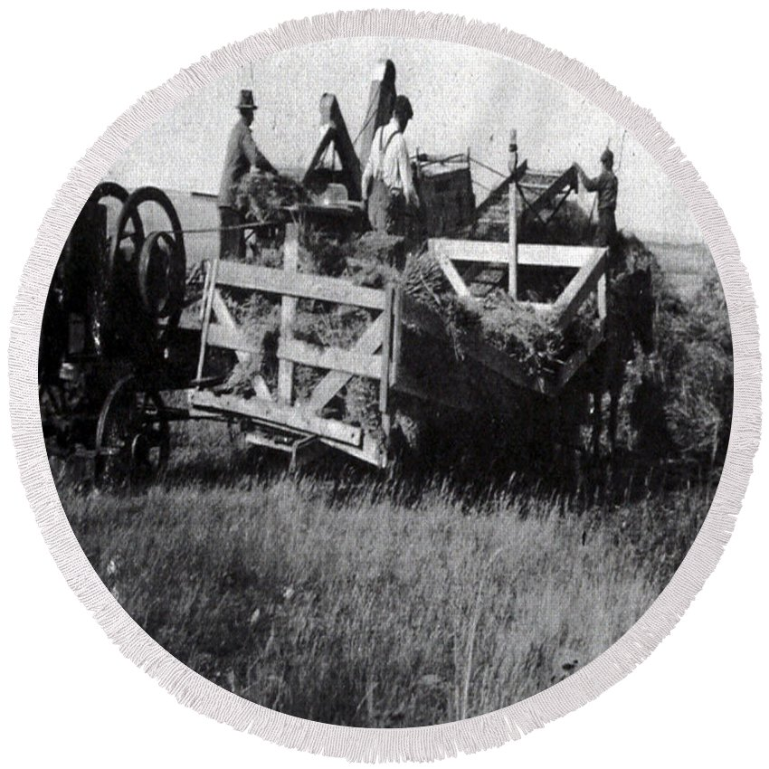 Old Photo Black And White Classic Saskatchewan Pioneers History Thresher Farming Round Beach Towel featuring the photograph Threshing Day by Andrea Lawrence