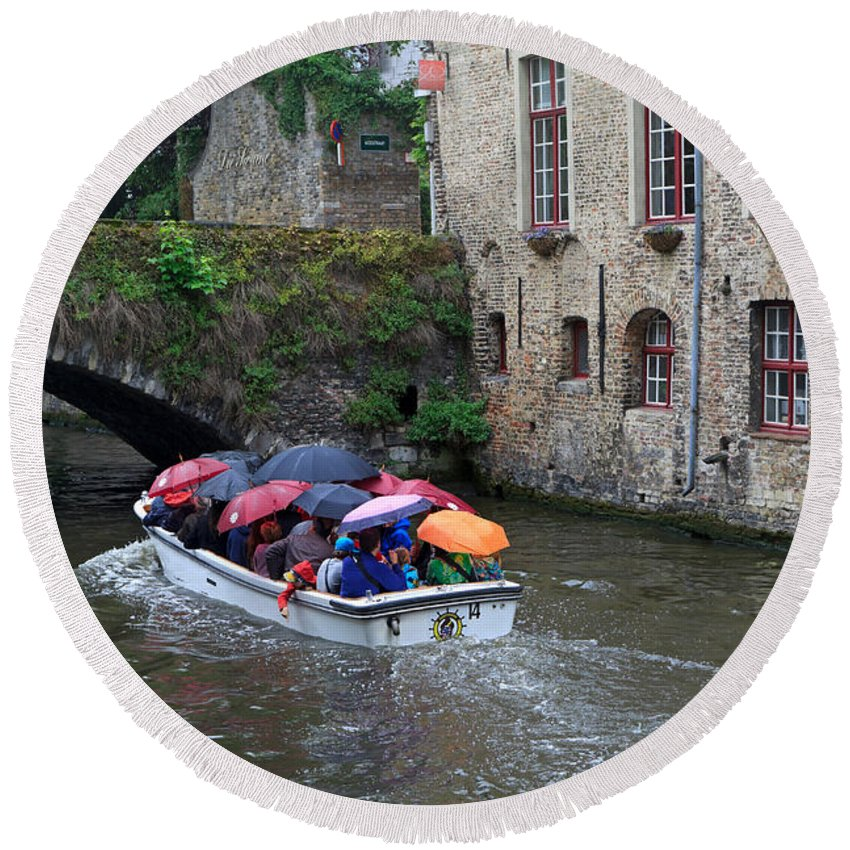 Tourists Round Beach Towel featuring the photograph Tourists With Umbrellas In A Sightseeing Boat On The Canal In Bruges by Louise Heusinkveld
