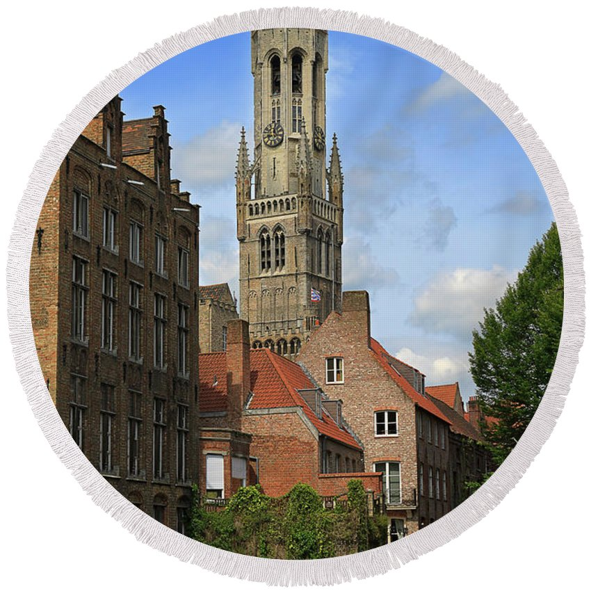 Bruges Round Beach Towel featuring the photograph Tower Of The Belfrey From The Canal At Rozenhoedkaai by Louise Heusinkveld