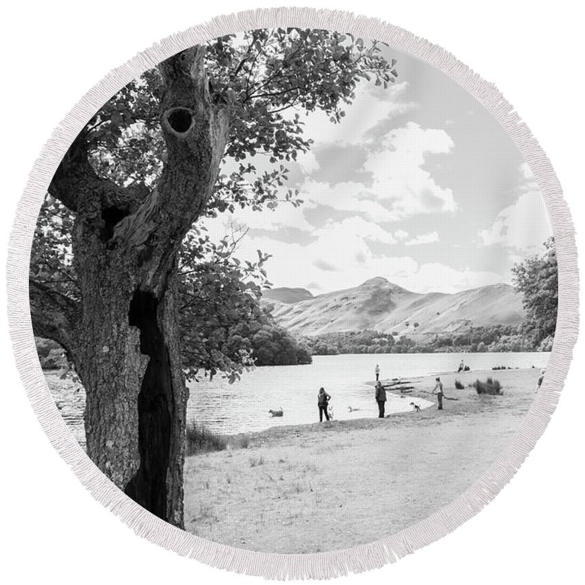 Cumbria Lake District Round Beach Towel featuring the photograph Tree And People By The Lake by Iordanis Pallikaras