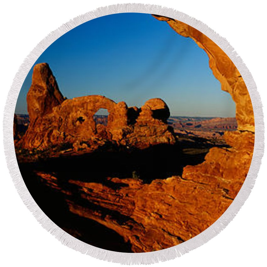 Photography Round Beach Towel featuring the photograph Turret Arch Through North Window by Panoramic Images