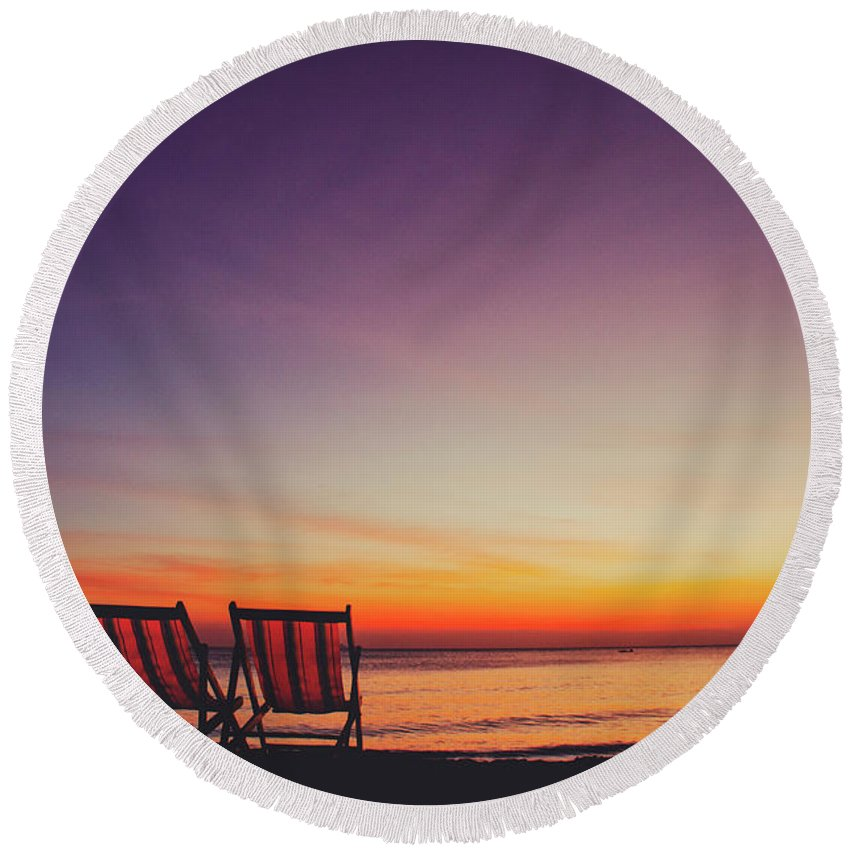 Appealing Round Beach Towel featuring the photograph Two Empty And Inviting Beach Chairs Next To The Sea During Beautiful Sunset On Koh Lanta Island by Srdjan Kirtic