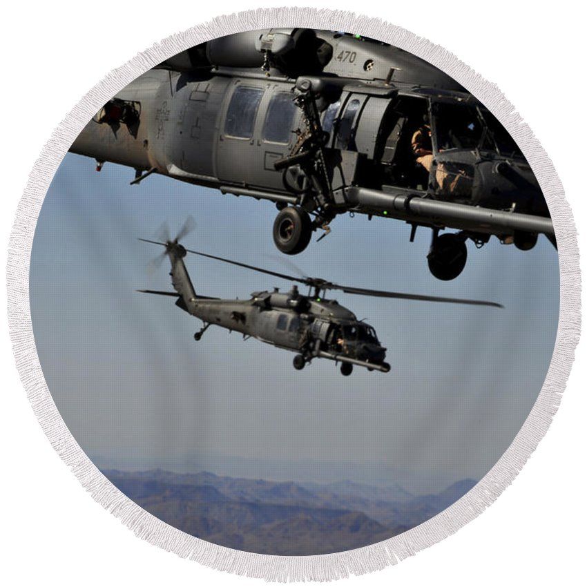 Airborne Round Beach Towel featuring the photograph Two Hh-60 Pave Hawk Helicopters Prepare by Stocktrek Images
