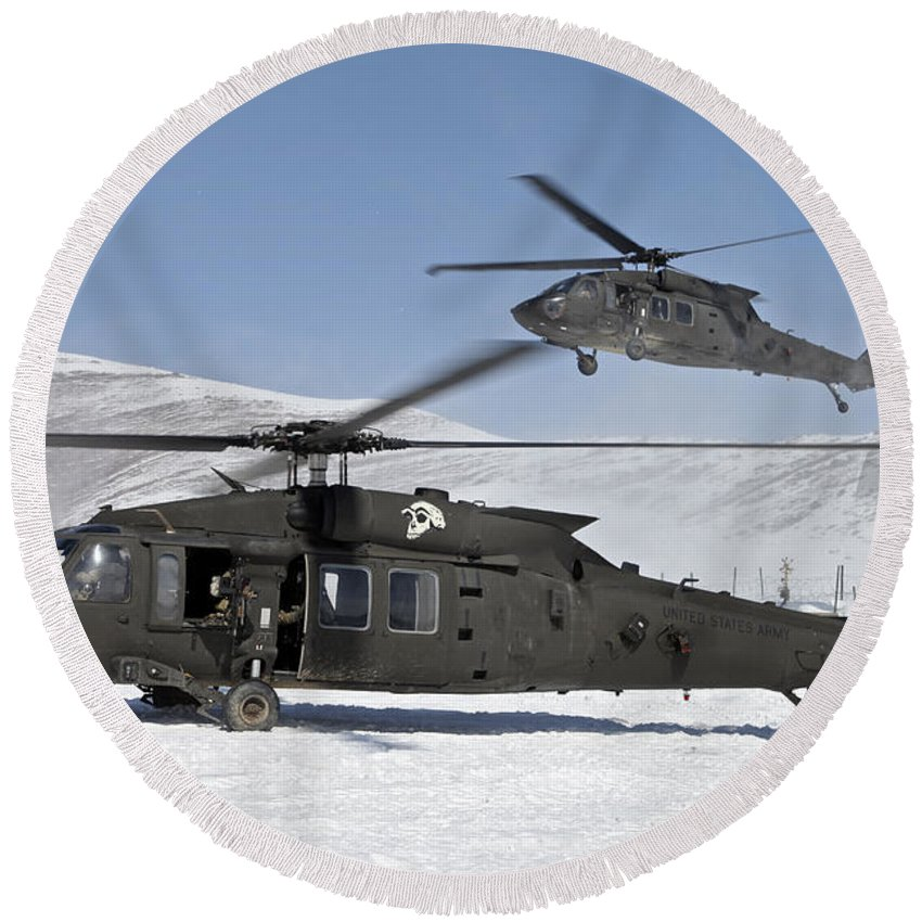 Us Army Round Beach Towel featuring the photograph Two U.s. Army Uh-60 Black Hawk by Stocktrek Images