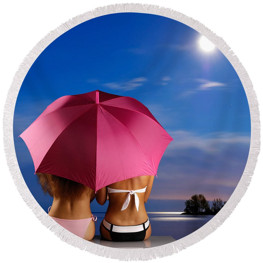 Beach Round Beach Towel featuring the photograph Two Women Relaxing On A Shore by Maxim Images Prints