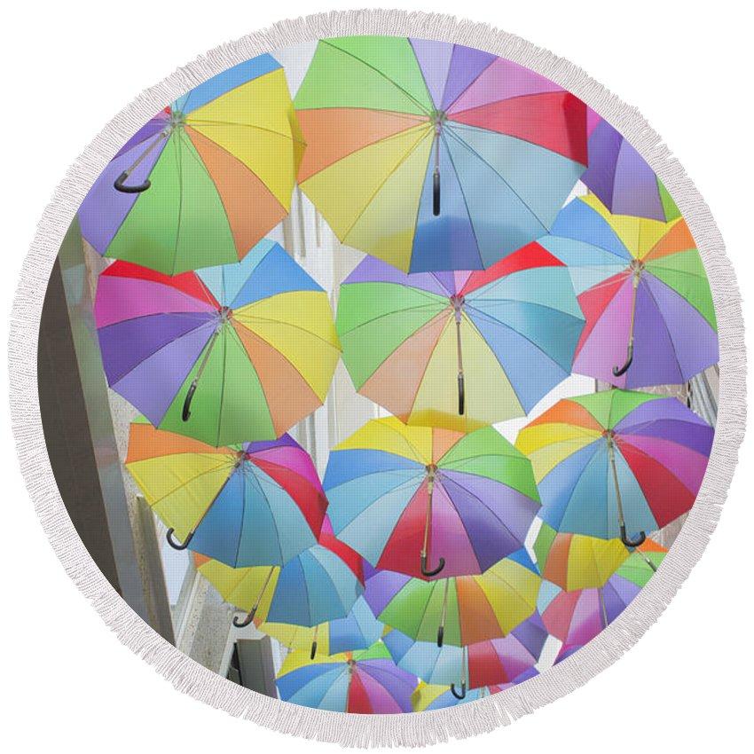 Larissa Antonova.under Umbrellas By Larissa Antonova / Multi-colored Umbrellas Round Beach Towel featuring the photograph Under Umbrellas by Larissa Antonova