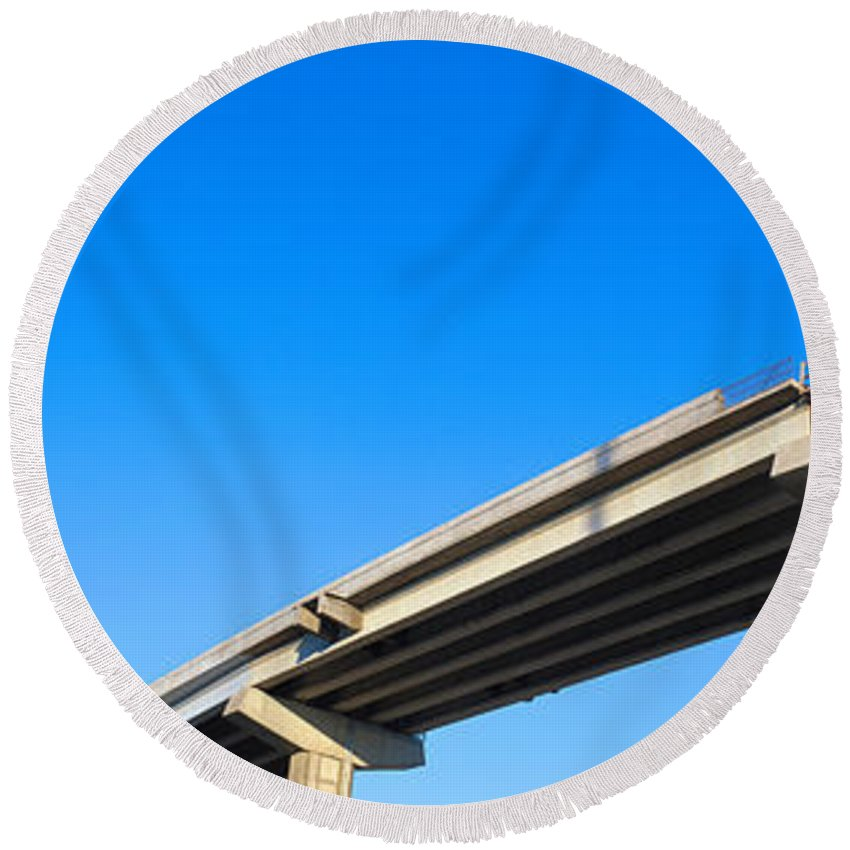 Photography Round Beach Towel featuring the photograph Unfinished Freeway Ramp by Panoramic Images