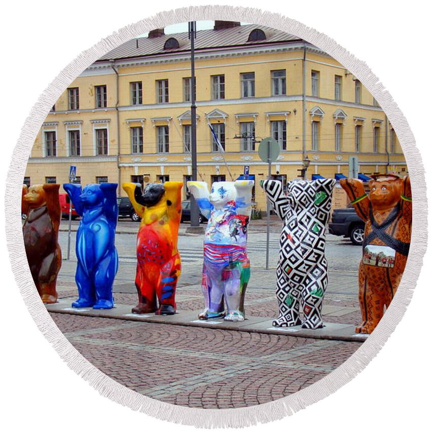 Helsinki Round Beach Towel featuring the photograph United Buddy Bear Statues At Helsinkis Senate Square by Richard Rosenshein