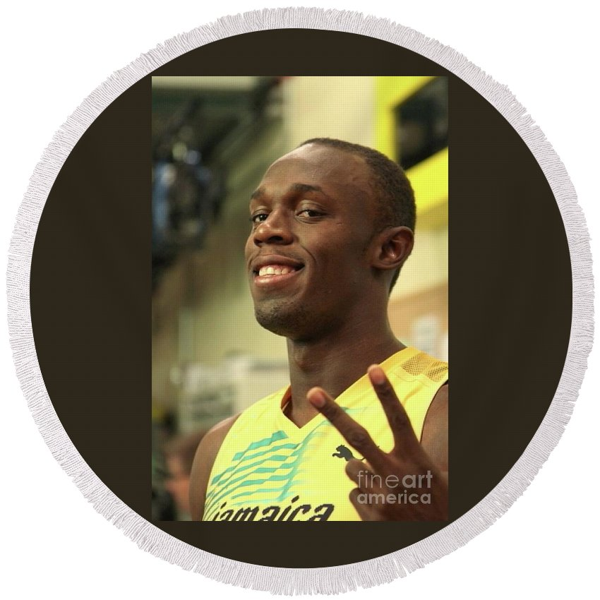 Running Champion Usain Bolt Is Shown Posing For The Camera In This Close Up Photo. Round Beach Towel featuring the photograph Usain Bolt by Concert Photos