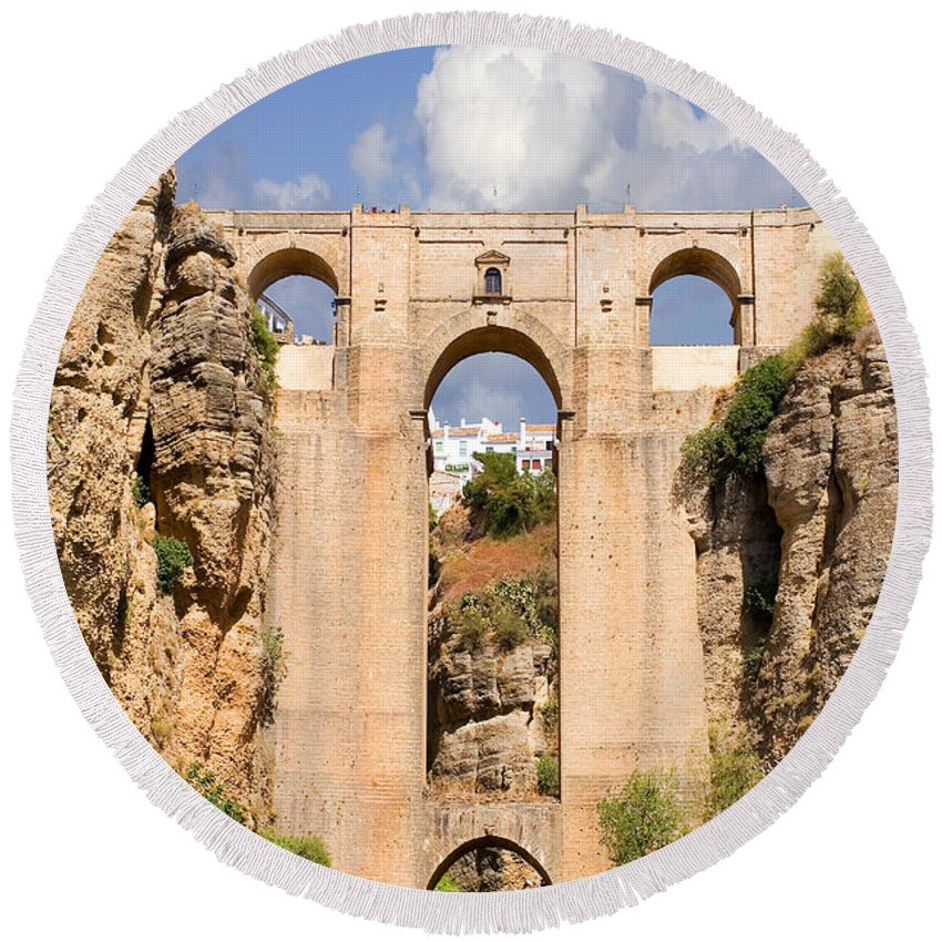Ronda Round Beach Towel featuring the photograph View Of The Tajo De Ronda And The Puente Nuevo Bridge From Across The Valley by Mal Bray