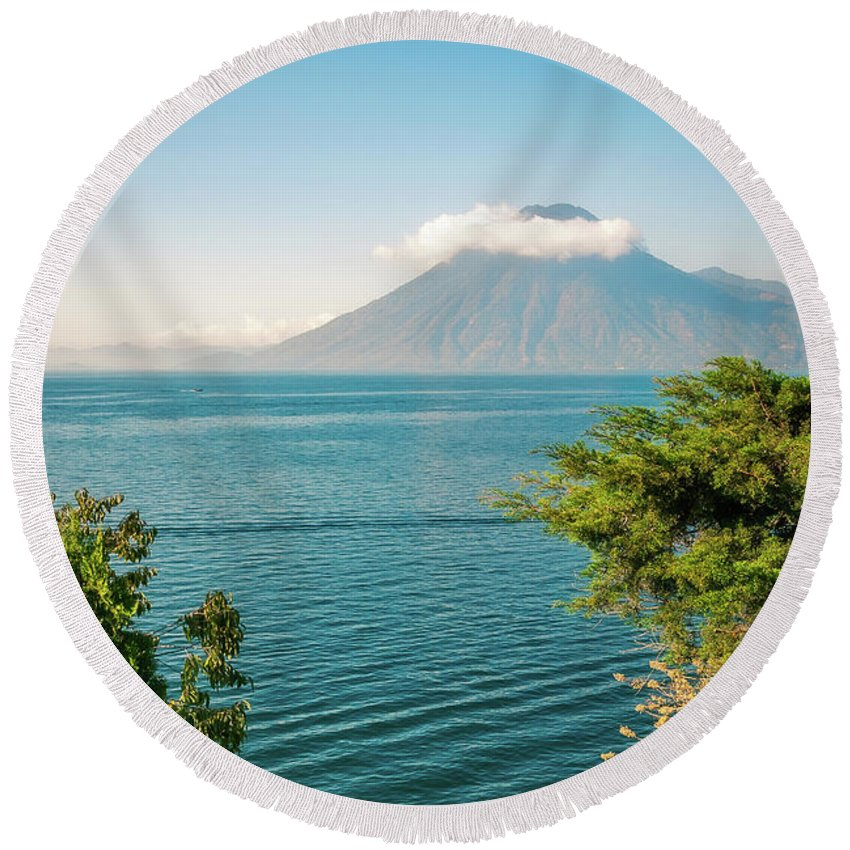 Atitlan Round Beach Towel featuring the photograph View Of Volcano San Pedro With A Crown Of Clouds In Guatemala by Daniela Constantinescu