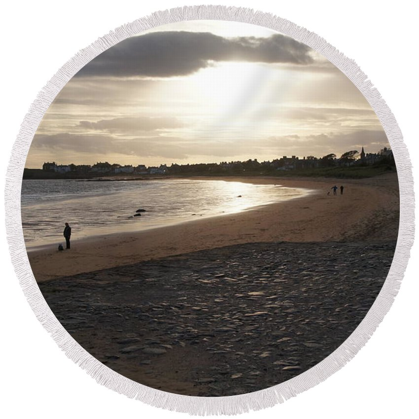 Elie And Earlsferry Round Beach Towel featuring the photograph Walking Toward The Sunset by Elena Perelman