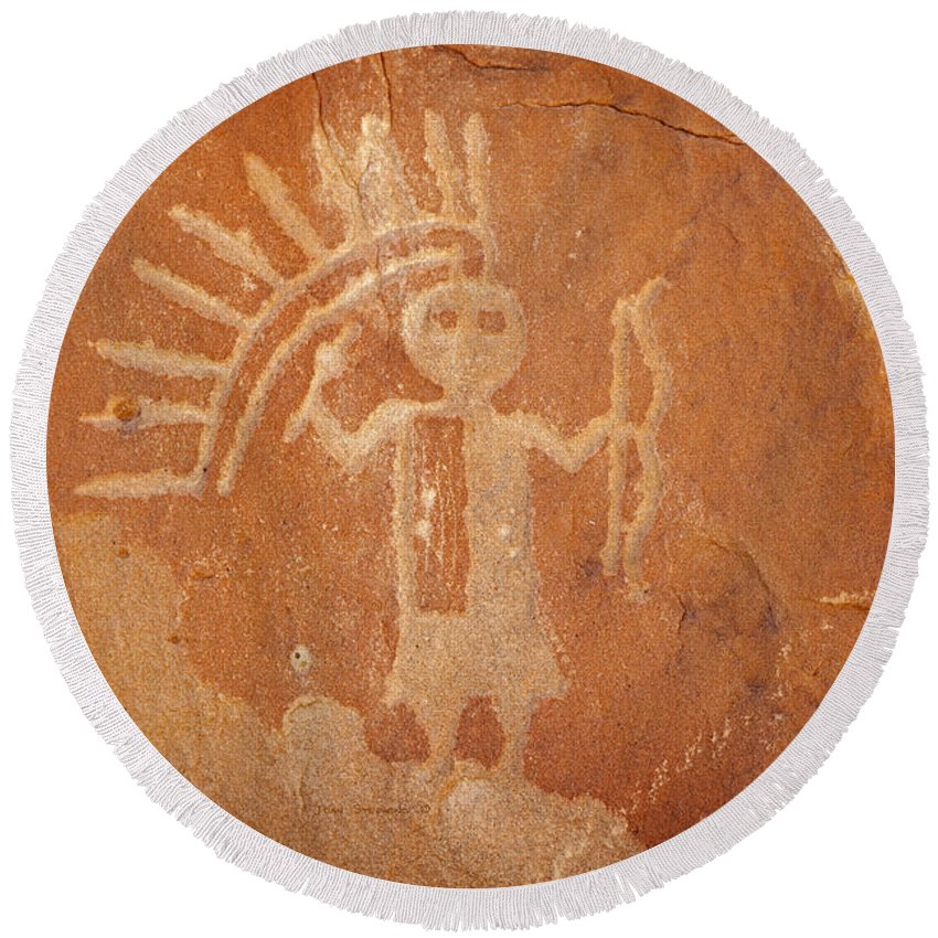 Petroglyphs Round Beach Towel featuring the photograph Native American Warrior Petroglyph On Orange Sandstone by John Stephens