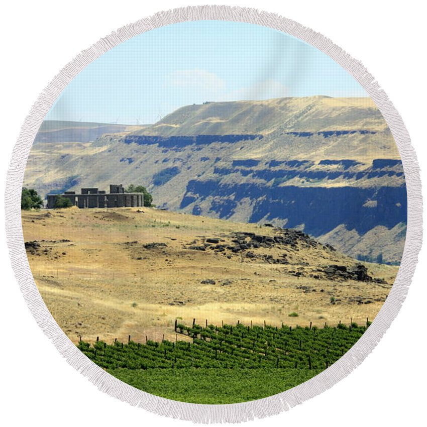 Washington State Round Beach Towel featuring the photograph Washington Stonehenge With Vineyard by Carol Groenen