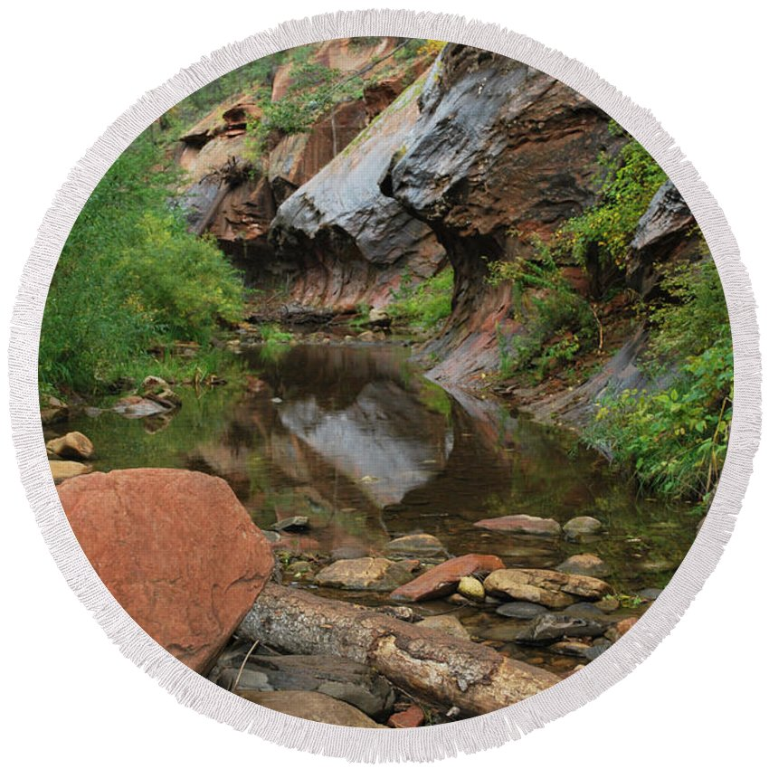 West Fork Trail River And Rock Vertical Sedona Arizona Oak Creek Canyon Wall Water Tree Bush Brush Leaf Pine Reflect Reflection Round Beach Towel featuring the photograph West Fork Trail River And Rock Vertical by Heather Kirk