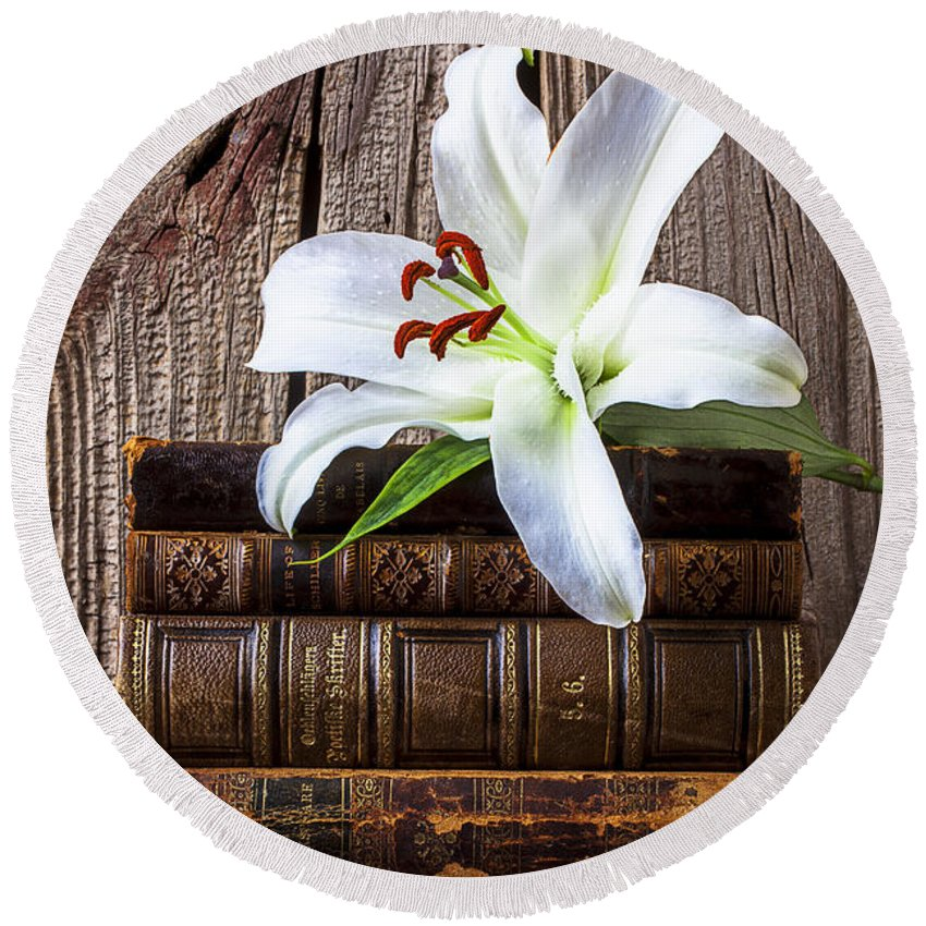 White Lily Round Beach Towel featuring the photograph White Lily On Antique Books by Garry Gay