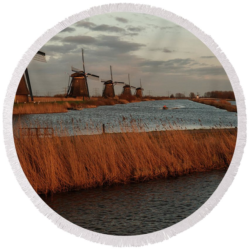 Round Beach Towel featuring the photograph Windmills In The Evening Sun by Manuel Posch