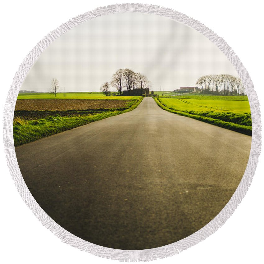 Vlaamse Ardennen Round Beach Towel featuring the photograph Winter Road Ground Level by Pati Photography