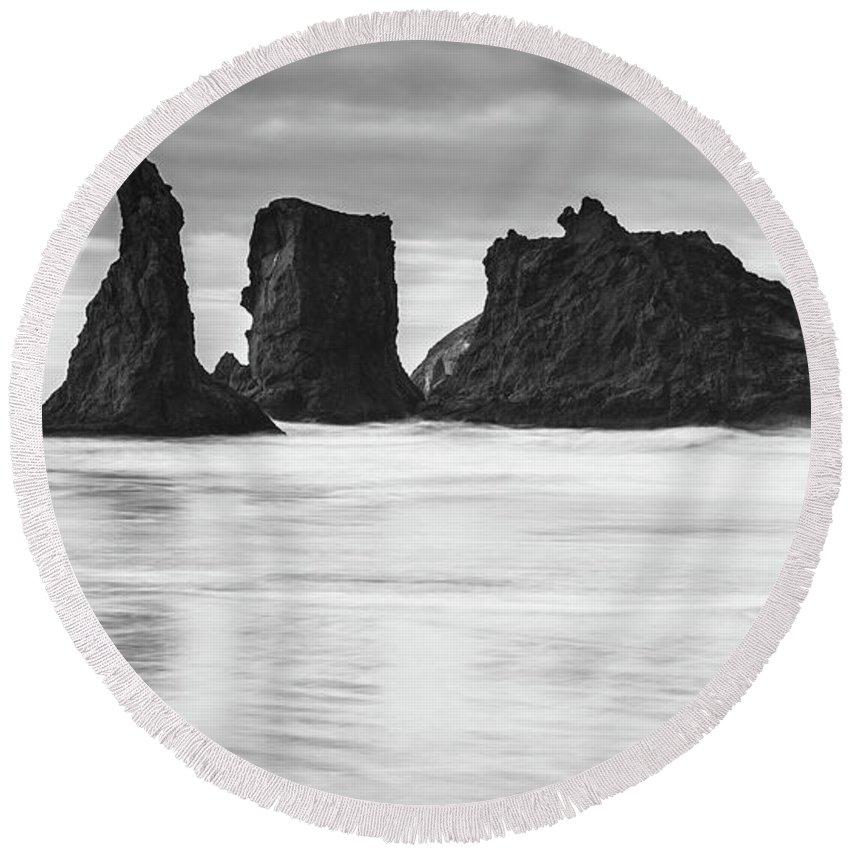 Bandon Round Beach Towel featuring the photograph Wizard's Hat Sea Stack - Black And White by Manuela Durson