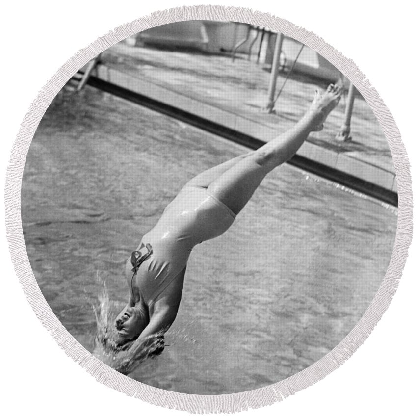1 Person Round Beach Towel featuring the photograph Woman Doing A Back Dive by Underwood Archives