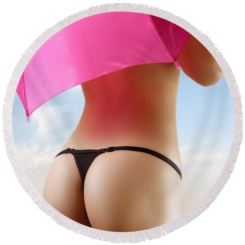 Beach Round Beach Towel featuring the photograph Woman In Bikini With A Pink Umbrella by Maxim Images Prints