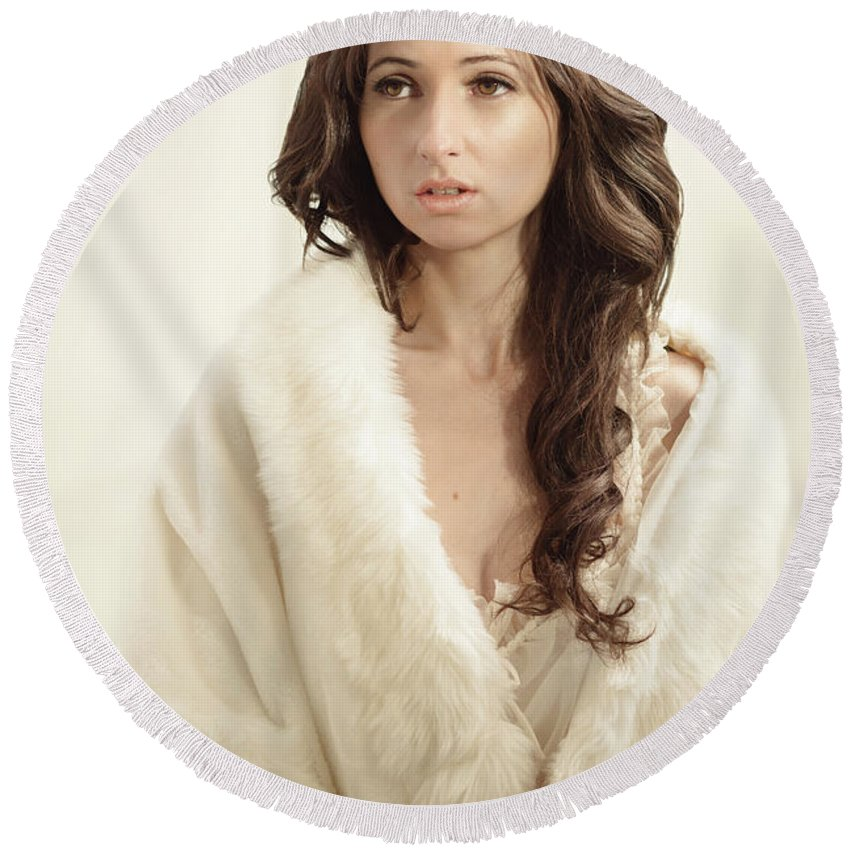 Negligee Round Beach Towel featuring the photograph Woman In Fur Wrap Wearing Crown by Amanda Elwell