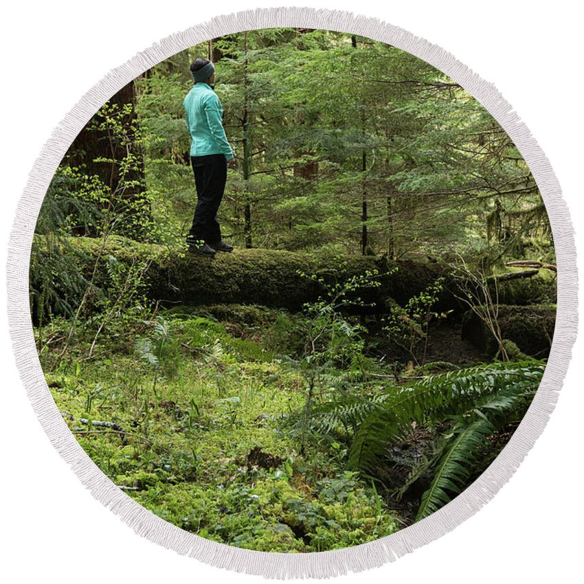 Olympic National Park Round Beach Towel featuring the photograph Woman On A Moss Covered Log In Olympic National Park by Brandon Alms