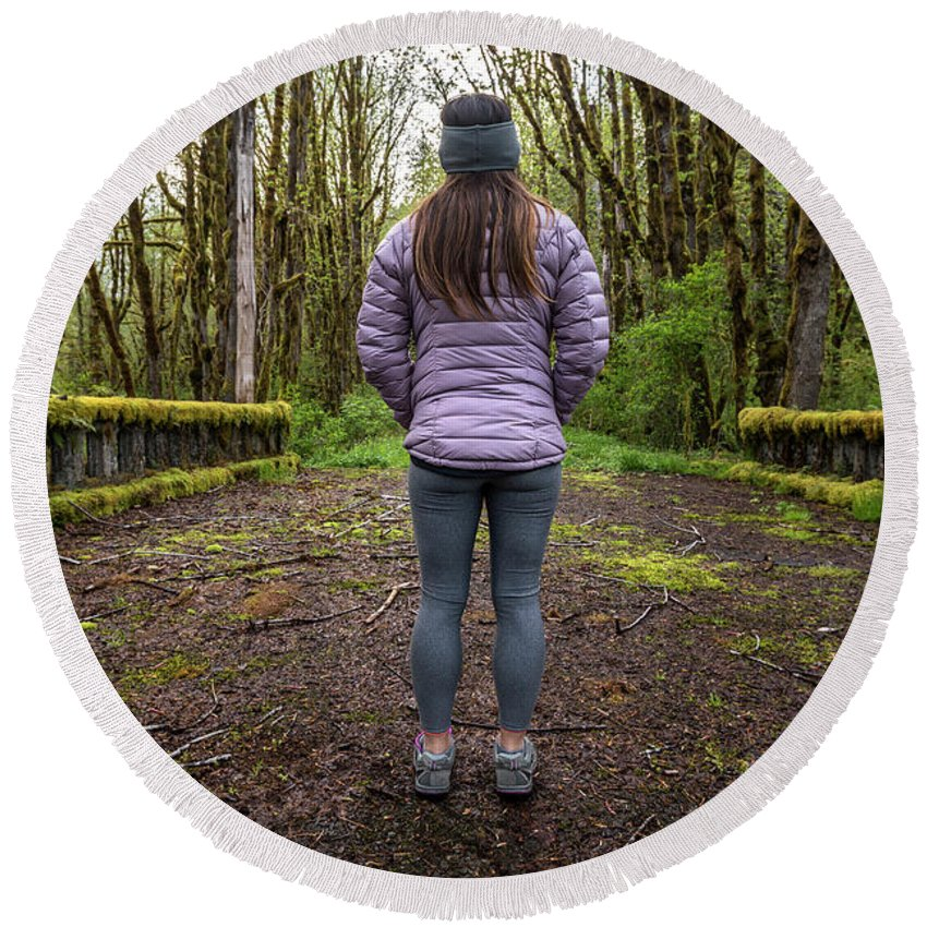 Olympic National Park Round Beach Towel featuring the photograph Woman On An Old Moss Covered Bridge In Olympic National Park by Brandon Alms