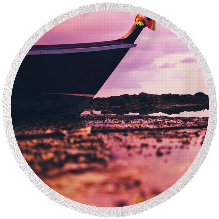Alone Round Beach Towel featuring the photograph Wooden Fishing Thai Boat Sunken On The Rocky Beach During Tide by Srdjan Kirtic