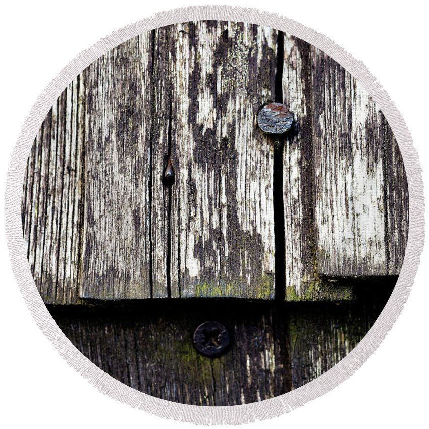 Background Round Beach Towel featuring the photograph Wooden Plate With Nails by Jozef Jankola