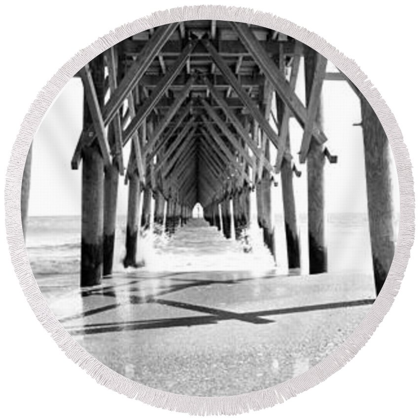 Photography Round Beach Towel featuring the photograph Wooden Post Under A Pier On The Beach by Panoramic Images