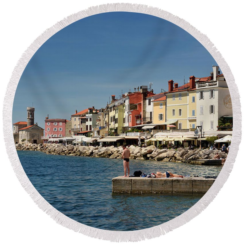 Young Round Beach Towel featuring the photograph Young Couple Fishing Reading Sunbathing On Dock At Piran Sloveni by Reimar Gaertner